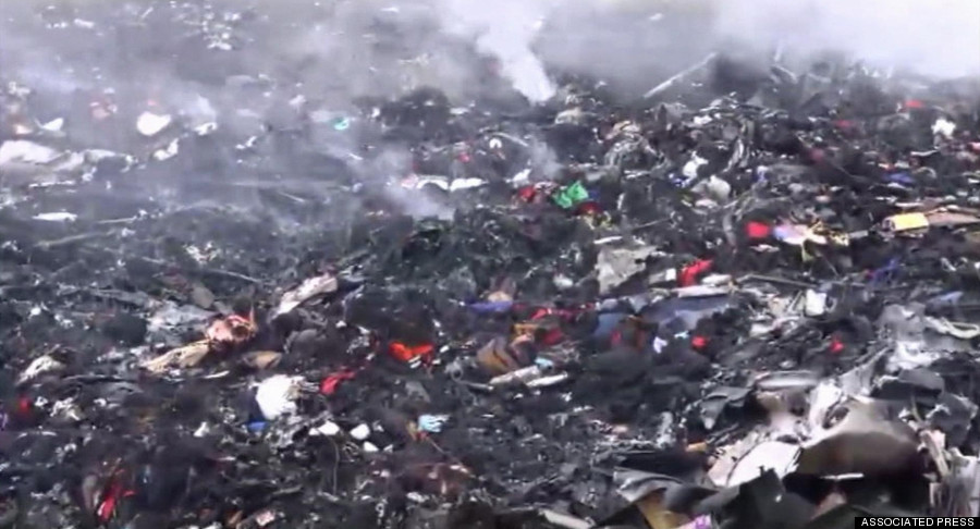 In this image taken from video, Thursday July 17, 2014, showing debris at the crash site after a passenger plane carrying 295 people was shot down Thursday as it flew over Ukraine, near the village of Hrabove, in eastern Ukraine. Malaysia Airlines tweeted that it lost contact with one of its flights as it was traveling from Amsterdam to Kuala Lumpur over Ukrainian airspace. (AP Photo / Channel 1) RUSSIA OUT - TV OUT